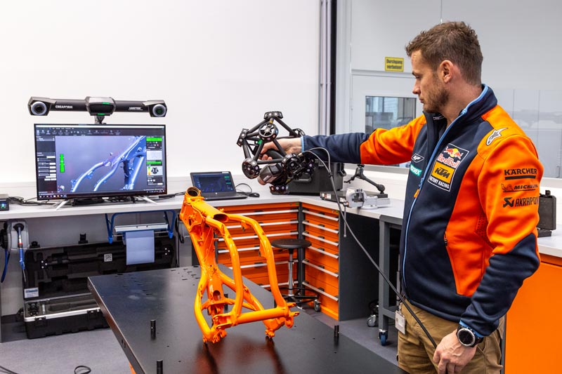 Quality Controller Motorsport Christian Schwarz performs 3D scanning of the motorcycle frame