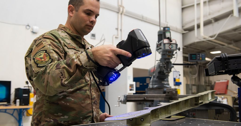 Army sergent 3D scans an aircraft structure at Air Force Base
