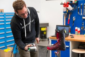 Scott Sports Product Engineer Bertrand Didier 3D scanning a ski boot prototype using a Creaform HandySCAN 3D handheld laser scanner in the design workshop to optimize product design