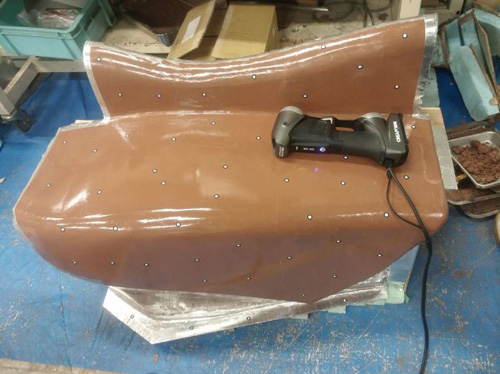 racing car clay model of the left side fairing ready to be 3d scanned by the HandySCAN