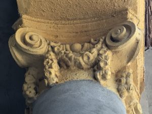Close-up of the top of a yellow column