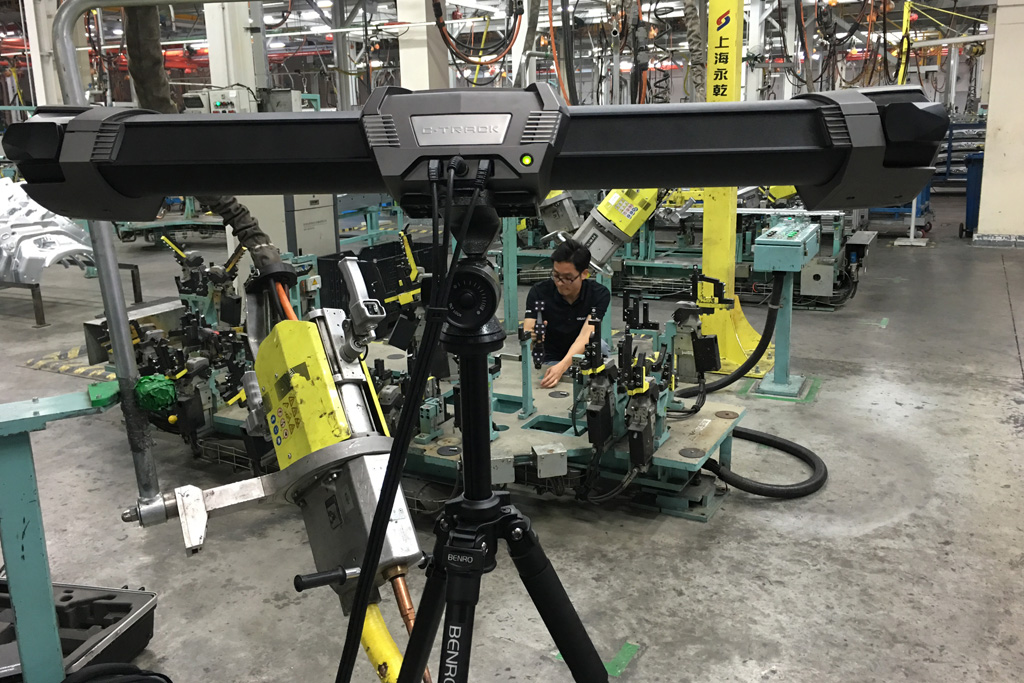 Quality technician performing jig and fixture adjustments on the shop floor using a handheld optical probing sytem