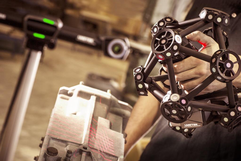 Creaform MetraSCAN 3D handheld laser scanner capturing 100% of the surface on a transmission casting.