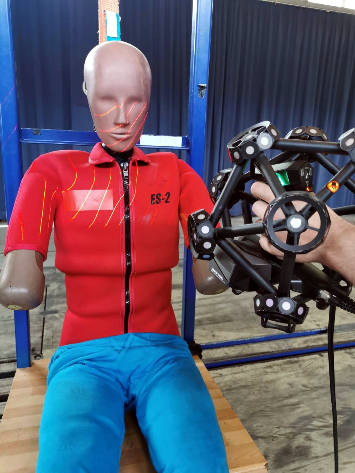 MetraSCAN 3D scanning red shirt dummy with lasers