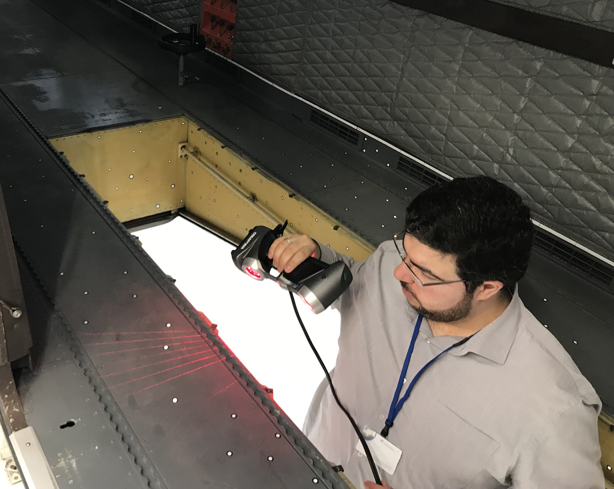 Employee scanning the floor hatch with the HandySCAN