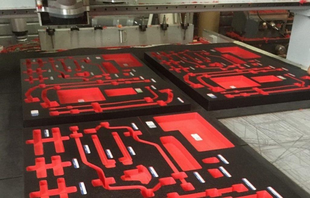 Three machined kitting tray ready to receive parts