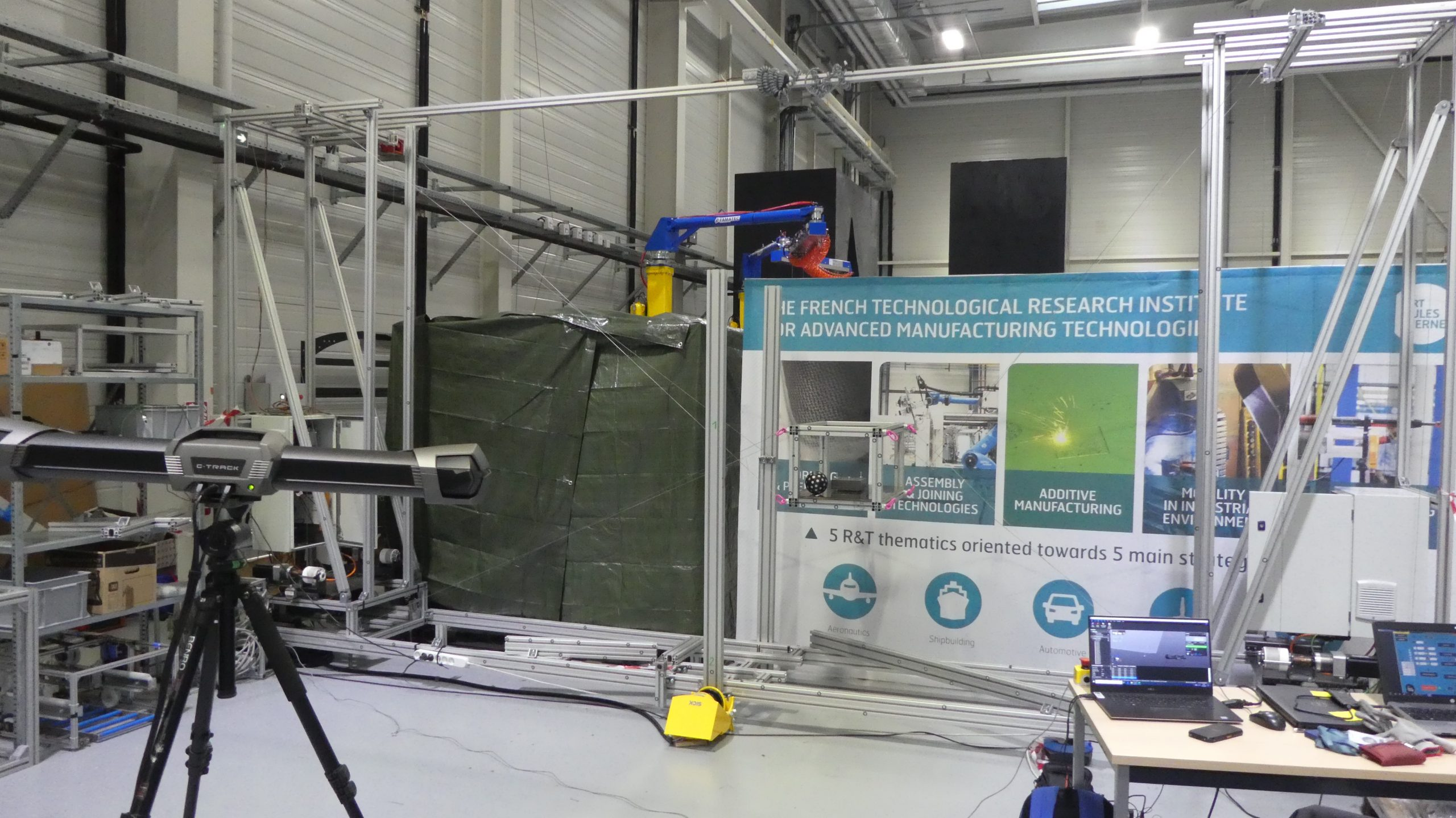 Research environment where a C-track evaluates a robot developed by IRT Jules-Verne