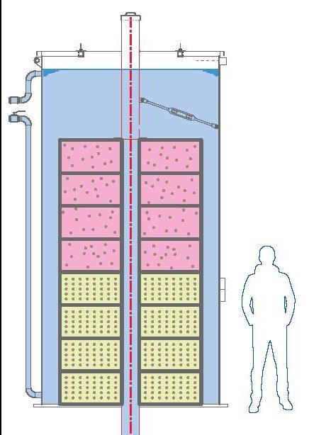 Silo contenant deux étalons rocheux composés de 8 blocs octogonaux de références empilés les uns sur les autres et carottés en leur centre. Dans ce carottage est introduit la sonde diagraphique à étalonner.