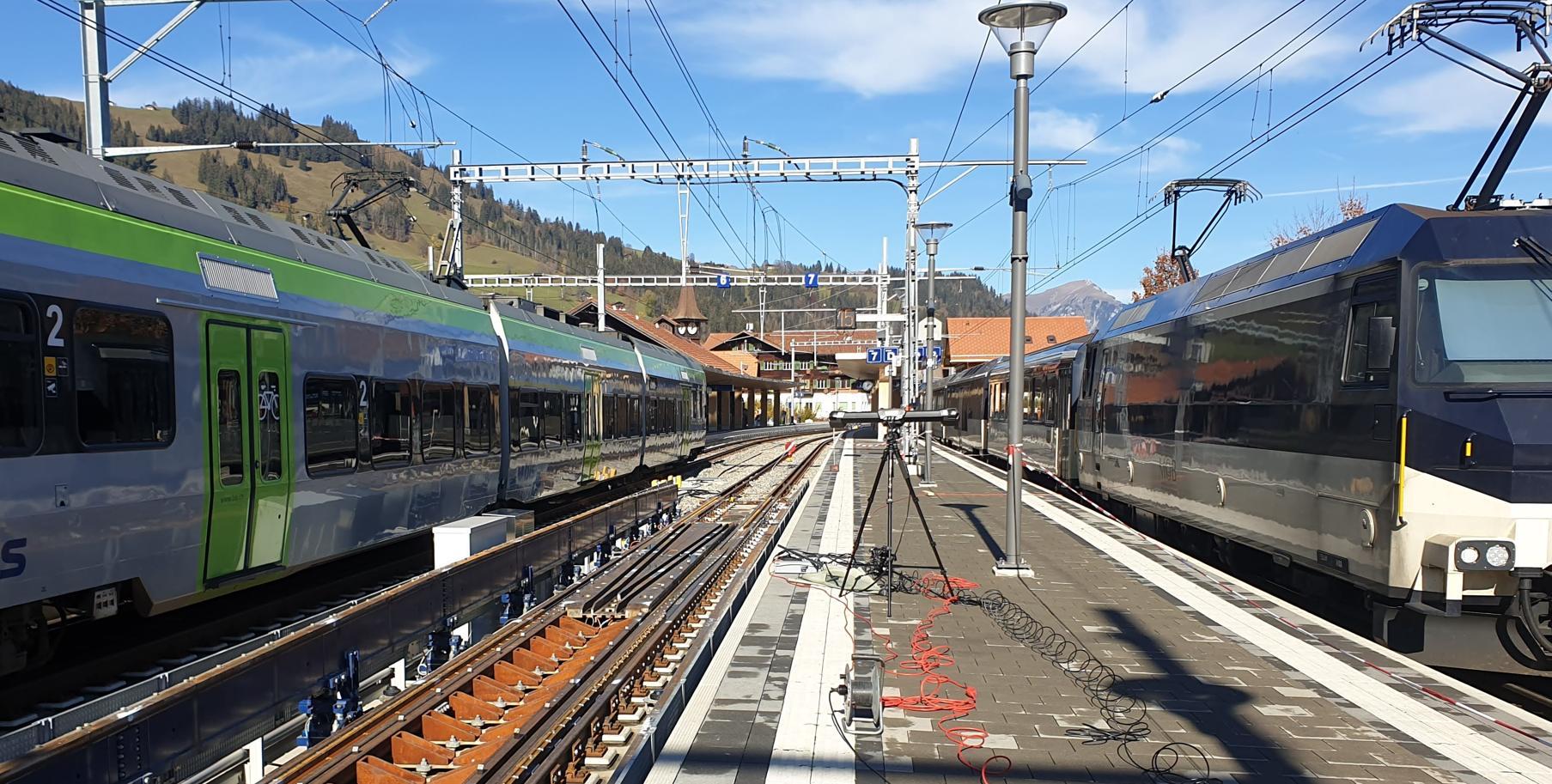 C-Track on atrain station platform between two trains