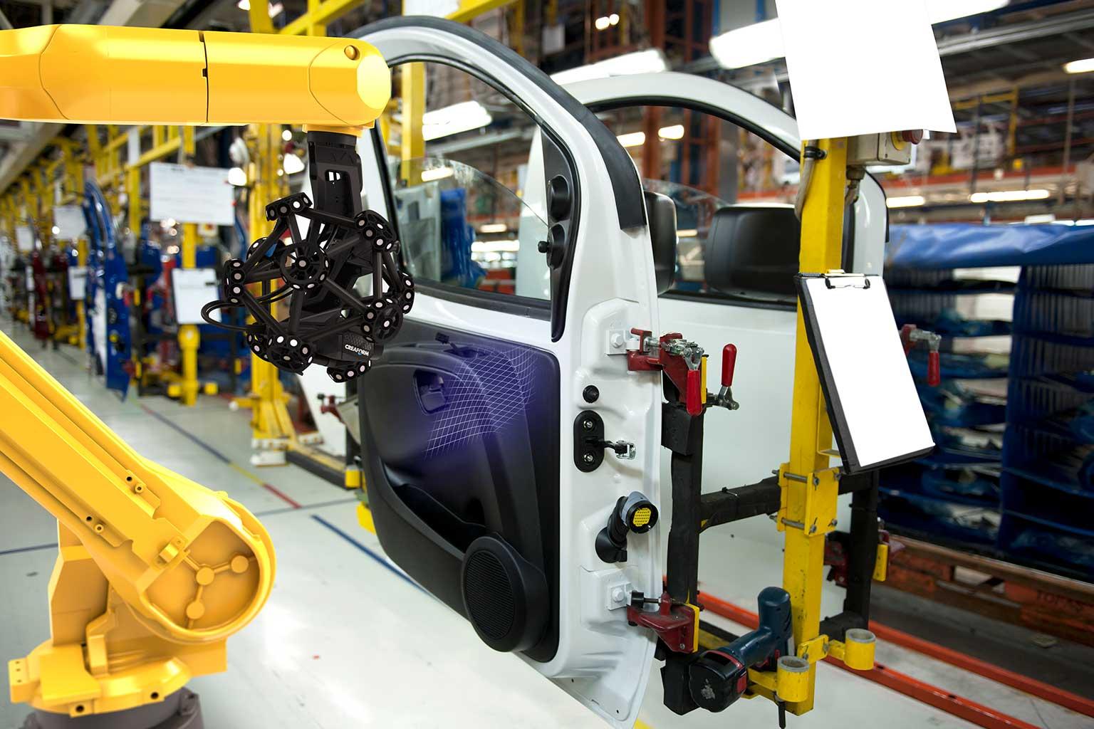 R-Series robot mounted MetraSCAN scanning white car door