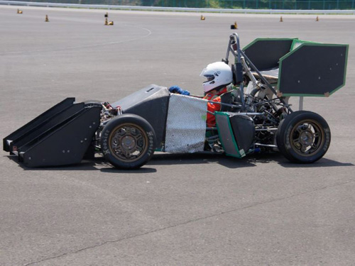 Test driving a racing car from student engineering team on a speedway
