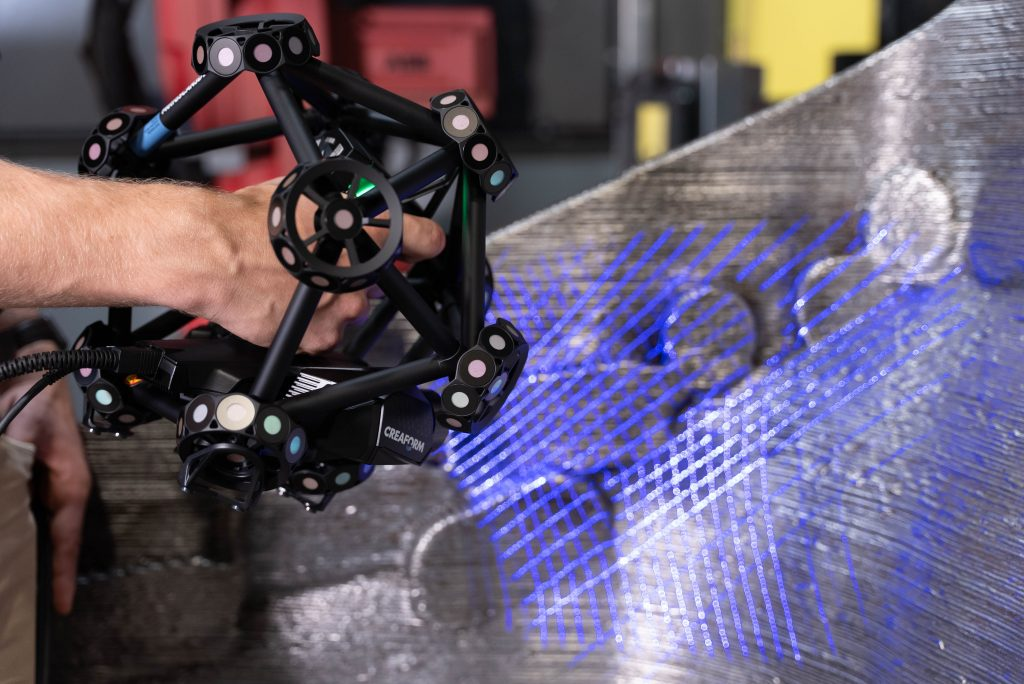 Close-up of a MetraSCAN 3D scanner being used to scan a large-scale metal 3D printing