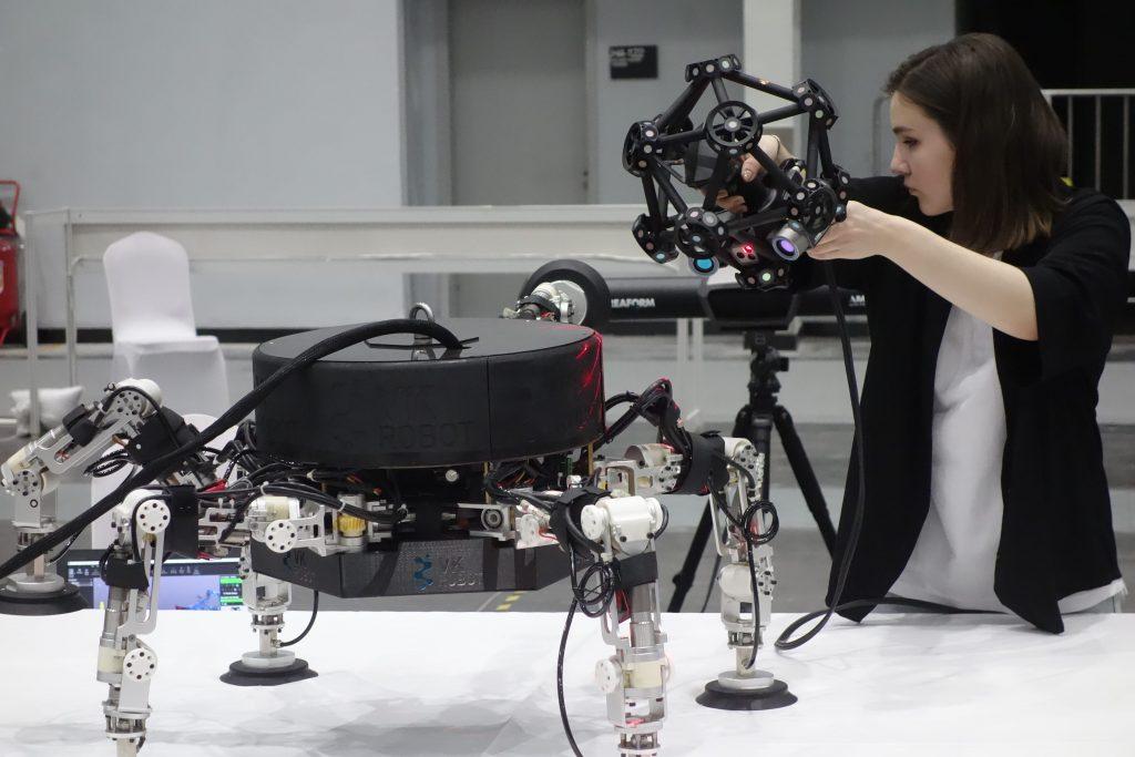 Women using metraSCAN to scan prototype robot
