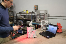 Real-time 3D scanning of the part with a Creaform 3D laser scanner